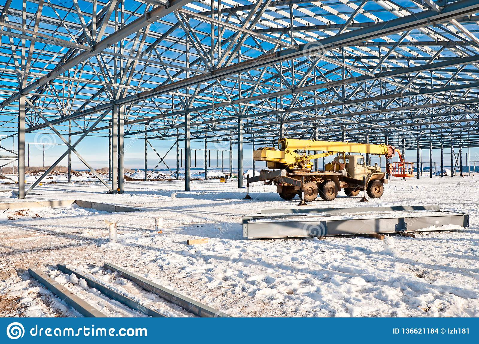 Steel construction on the background of the winter landscape.