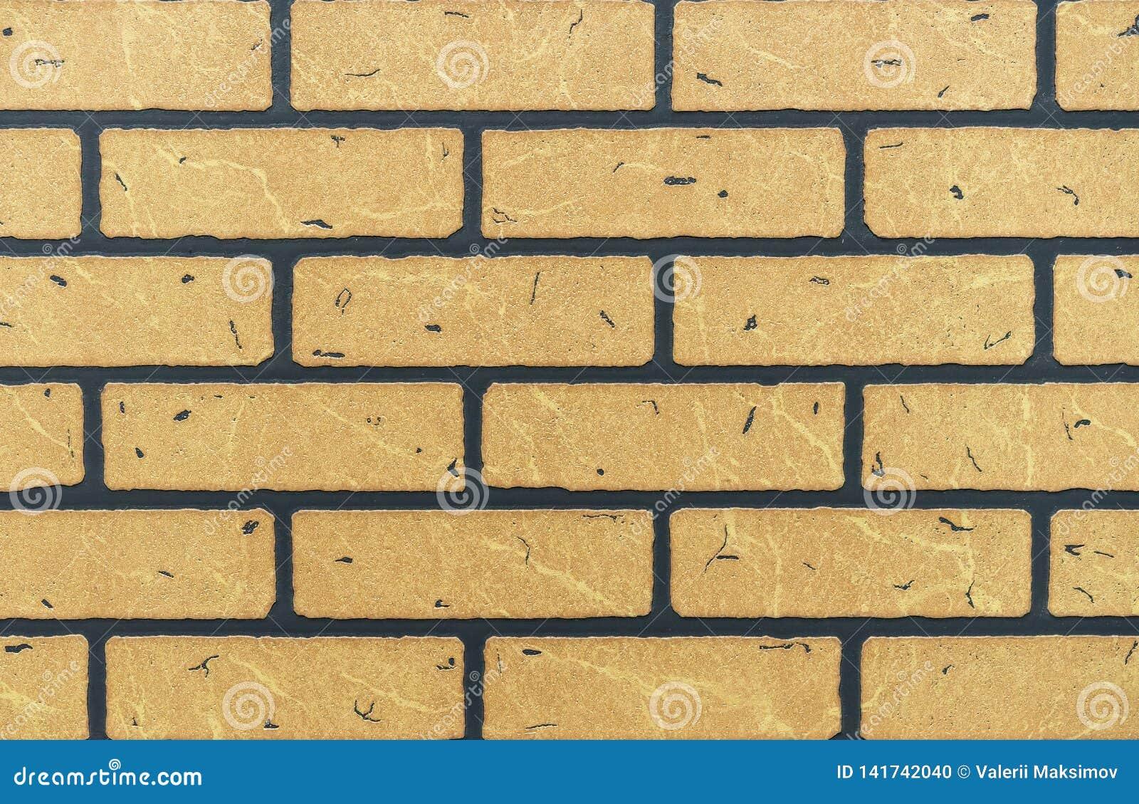 Struttura del muro di mattoni giallo per fondo