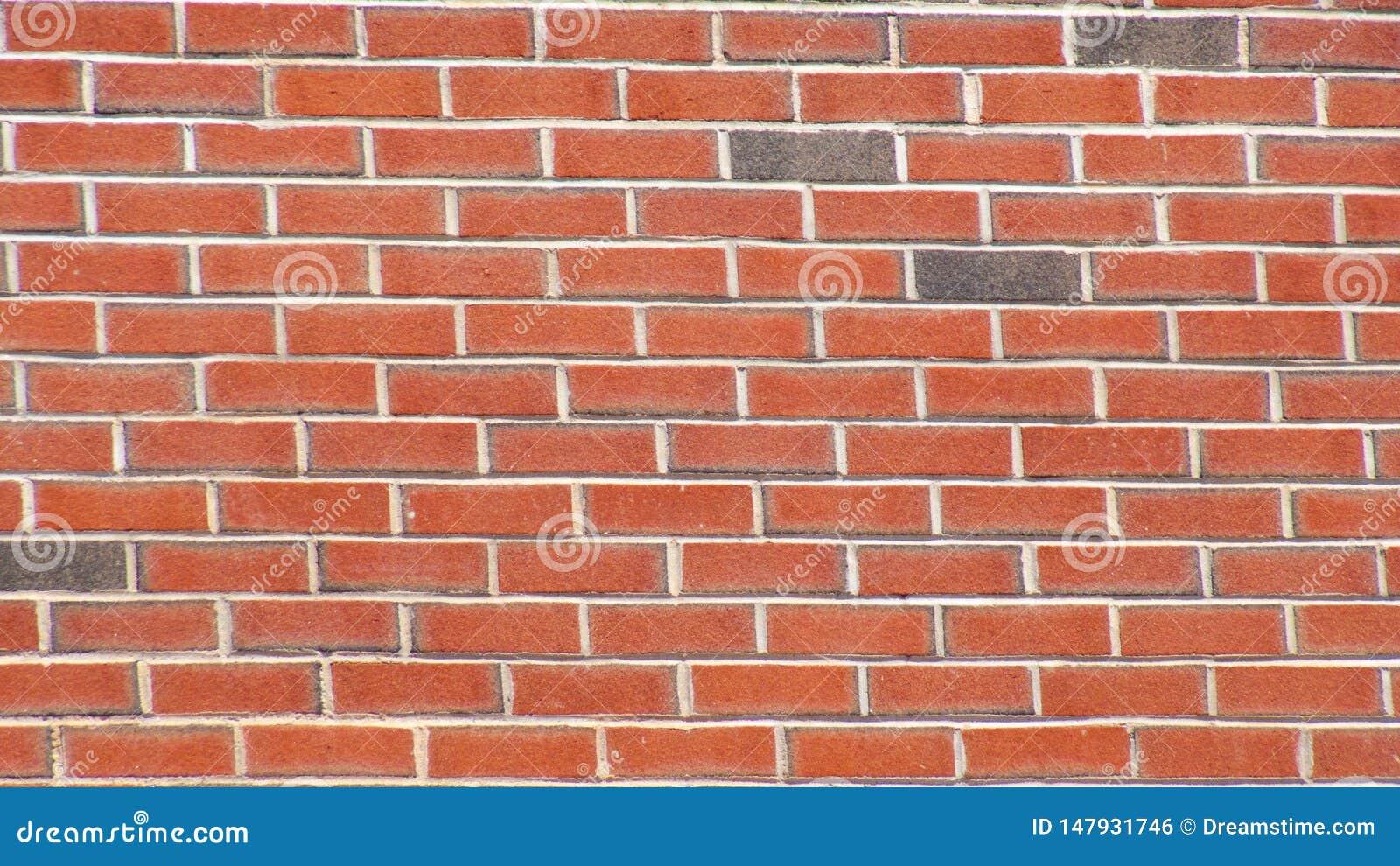 Struttura della carta da parati del fondo del muro di mattoni