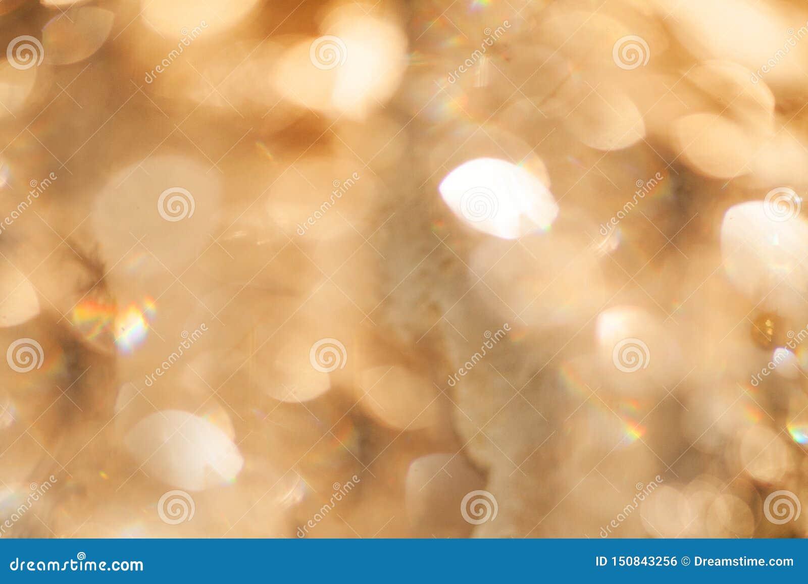 Struttura dorata del fondo del bokeh dell estratto