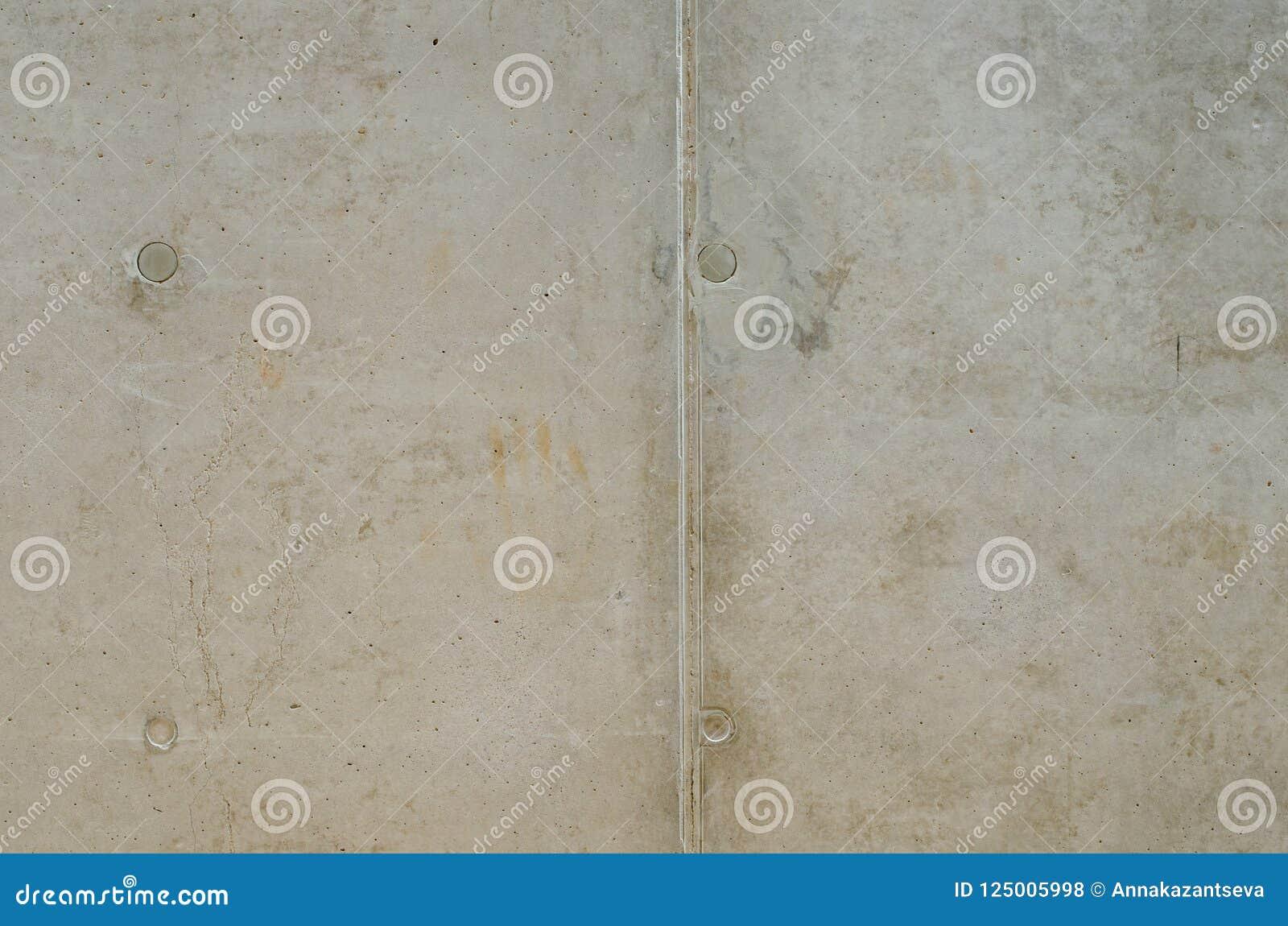 Struttura Grungy di vecchio muro di cemento grigio con quattro cerchi e l