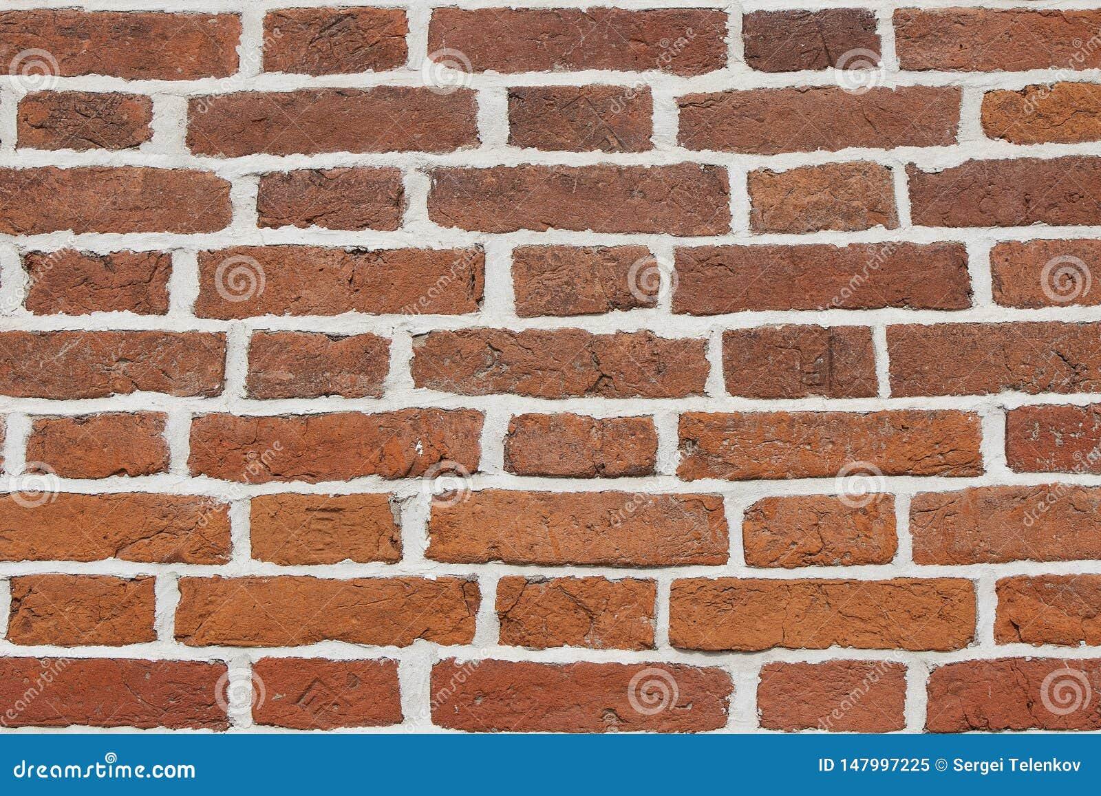 Strutturi la parete del mattone obsoleto rosso Fondo da vecchia muratura arancio con bianco
