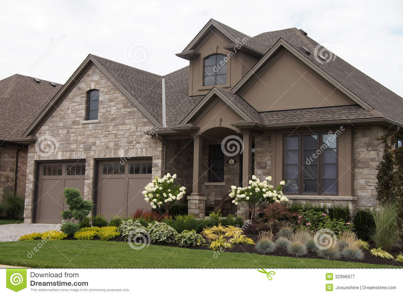 Stucco stone house pretty garden stock image image of for Stone and stucco house plans