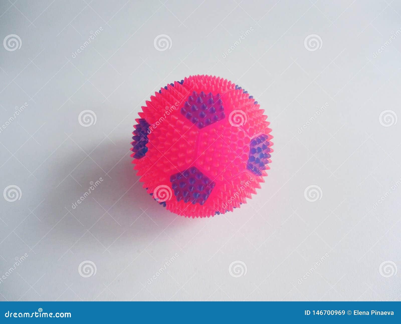 Studded ball on white background