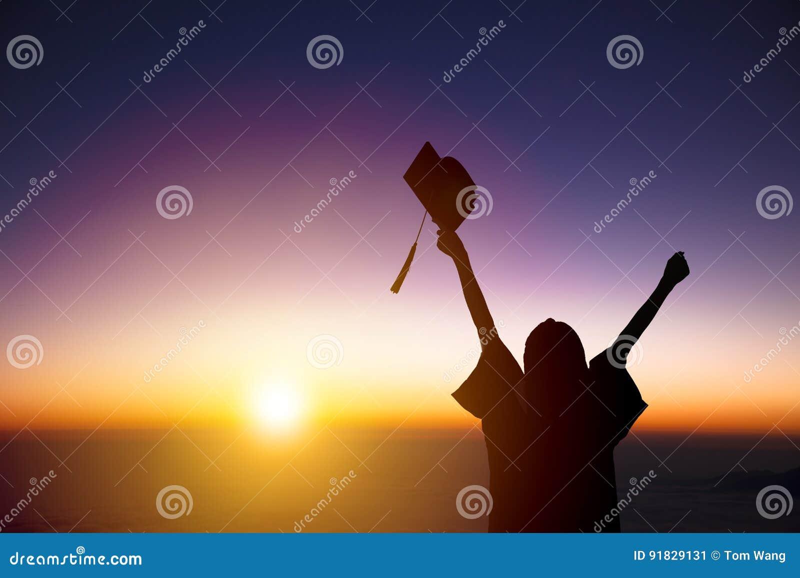 Student Celebrating Graduation watching the sunlight
