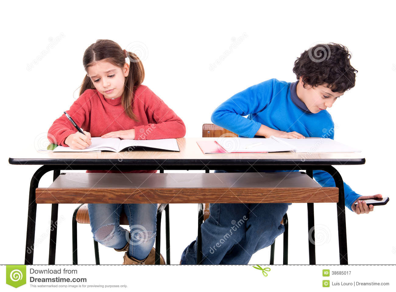 Boy Cheating With Cellphone In The Classroom Royalty Free Stock Photography