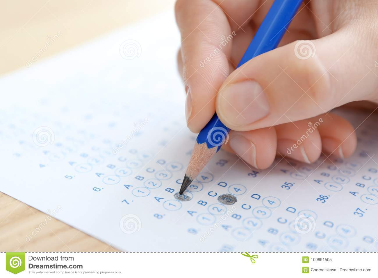 Student choosing answers in test form to pass exam