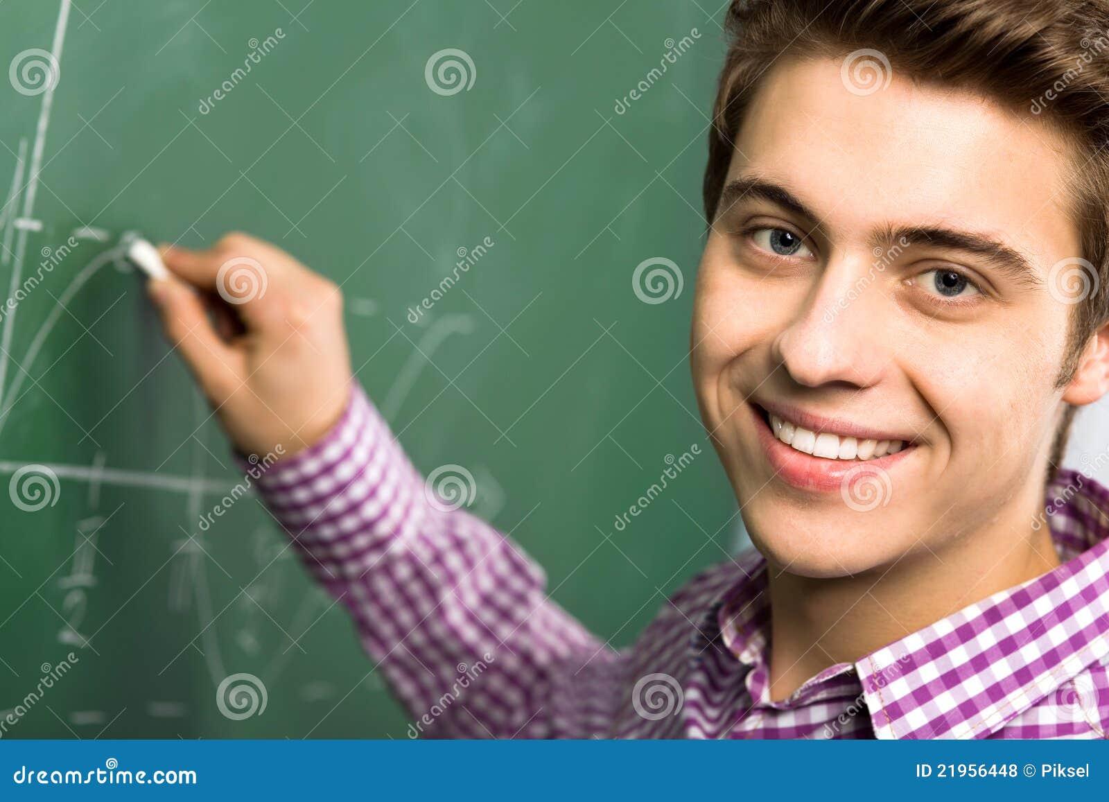 Student Doing Math On Chalkboard Stock Photo - Image of teenage ...