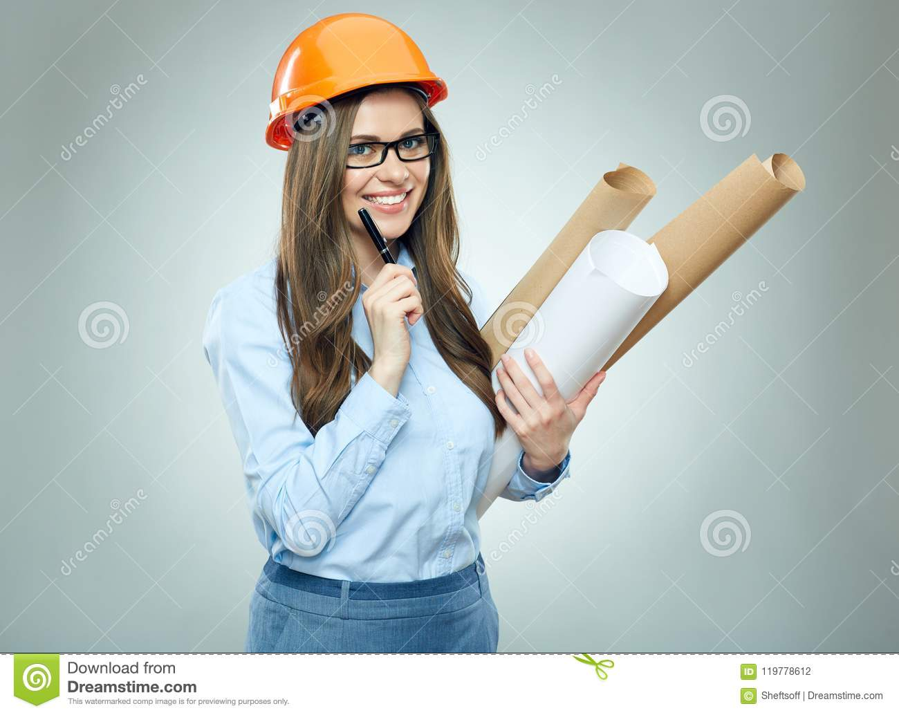 Student girl architect wearing glasses holding rolled up technical drawing.