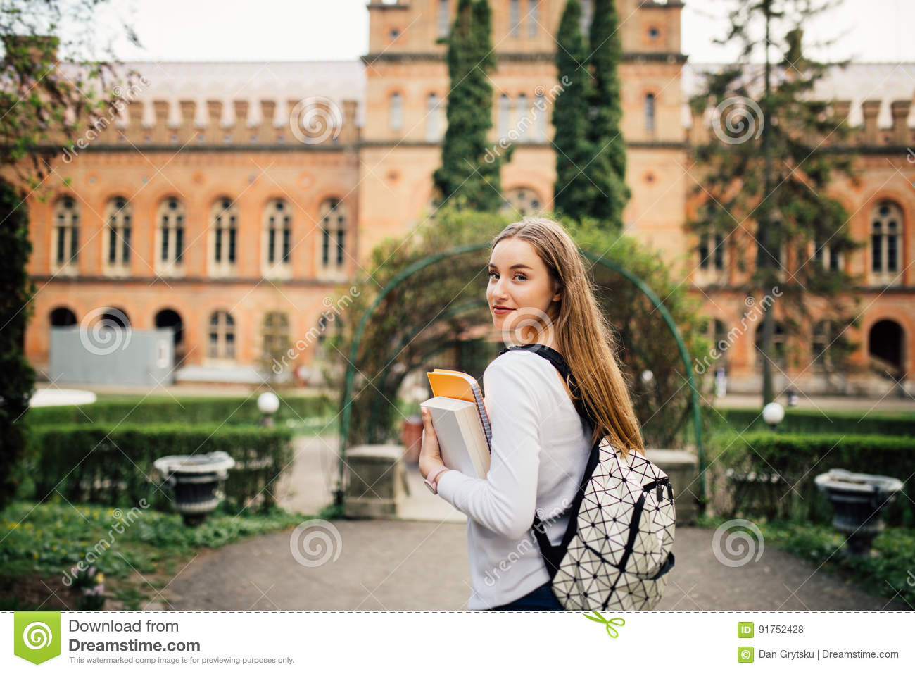 Student girl with book in University outfoors