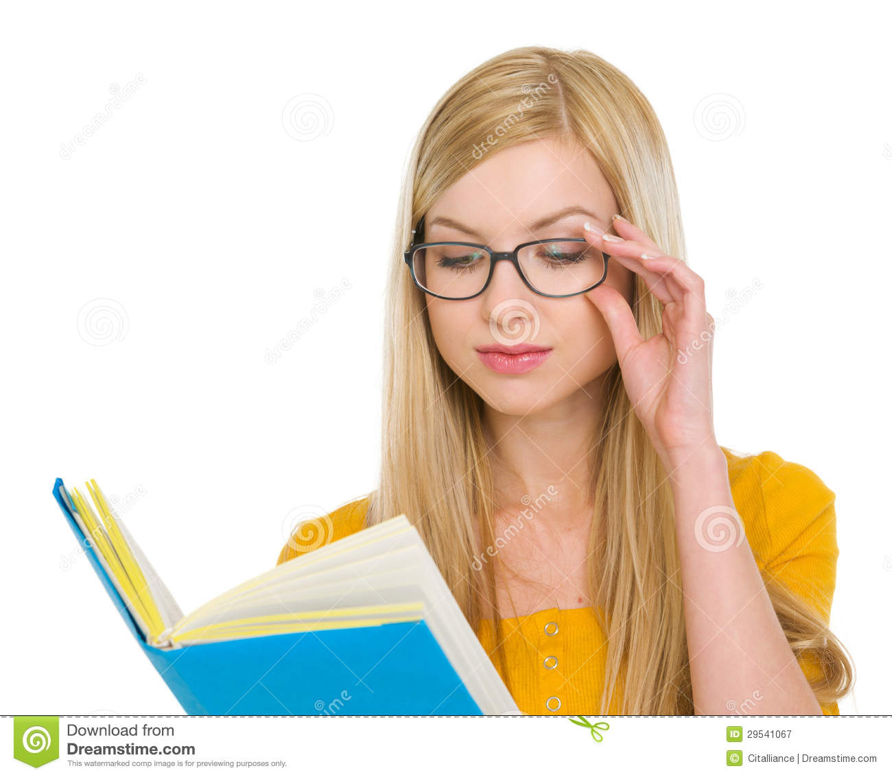 child girl in glasses reading book and smiling stock photo image
