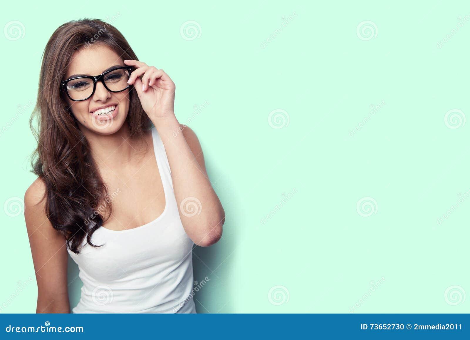 08d0b5cdfcd1 Student girl in white shirt and glasses on green background stock jpg  1300x957 White shirt glasses