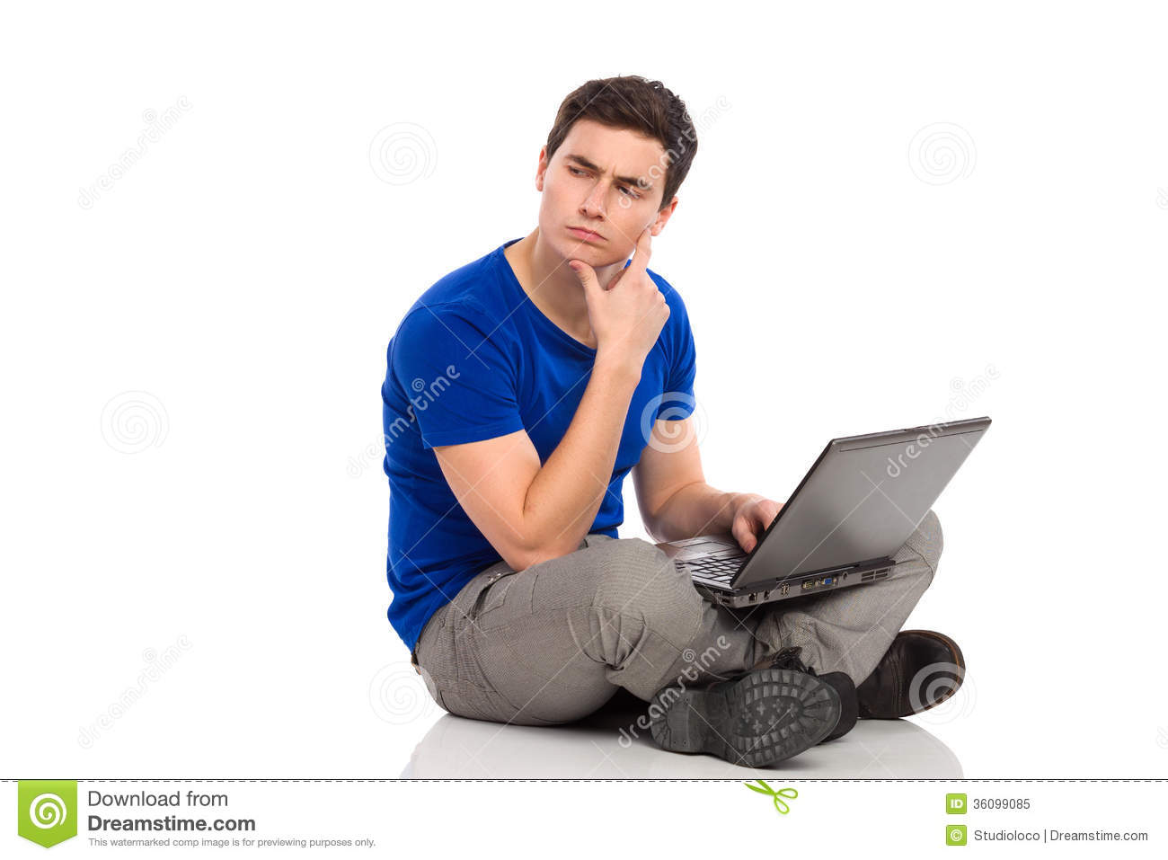 Young man with laptop thinking and looking at empty space. Full length ...