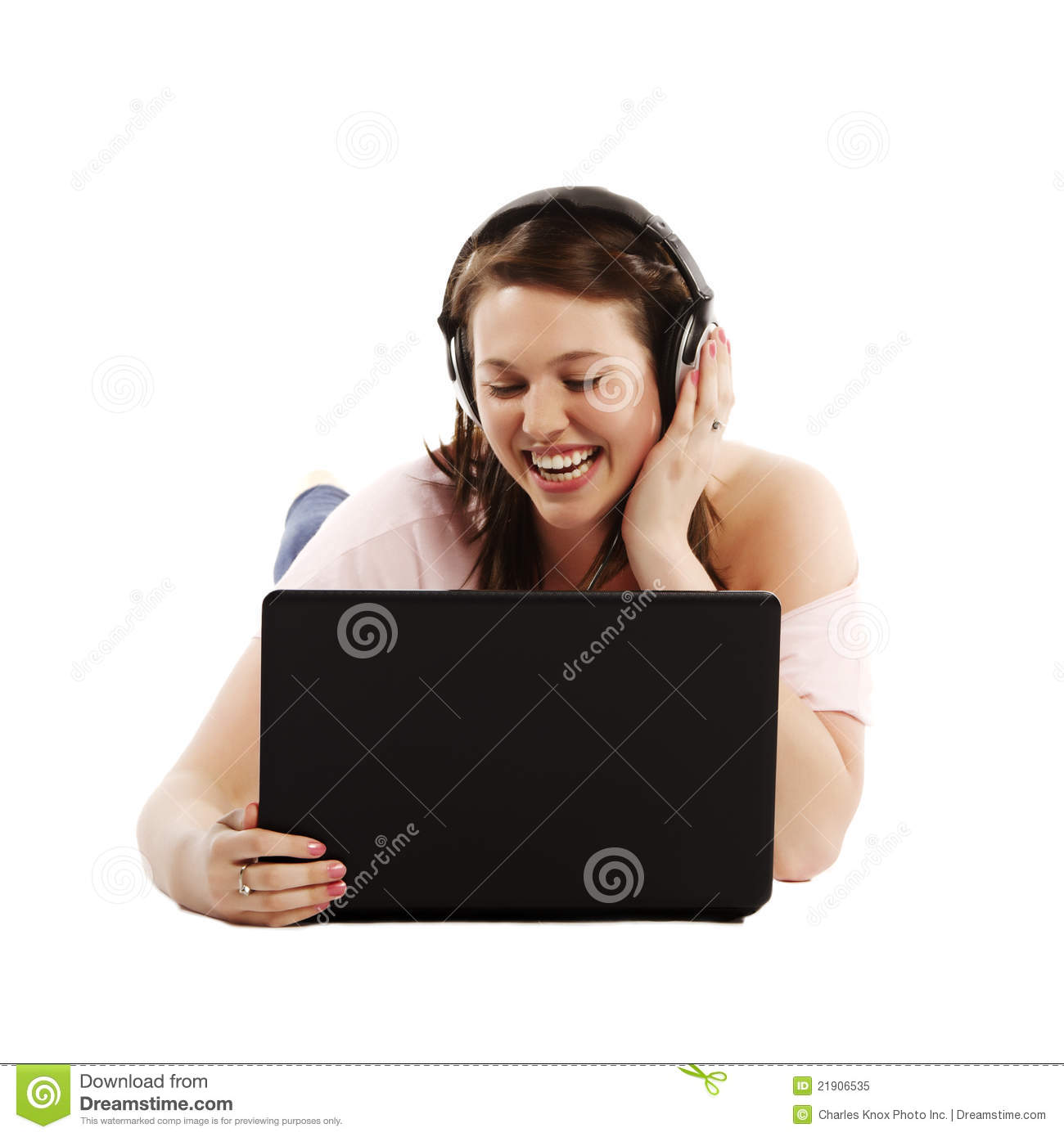 Casual student listening to music on her laptop while studying over