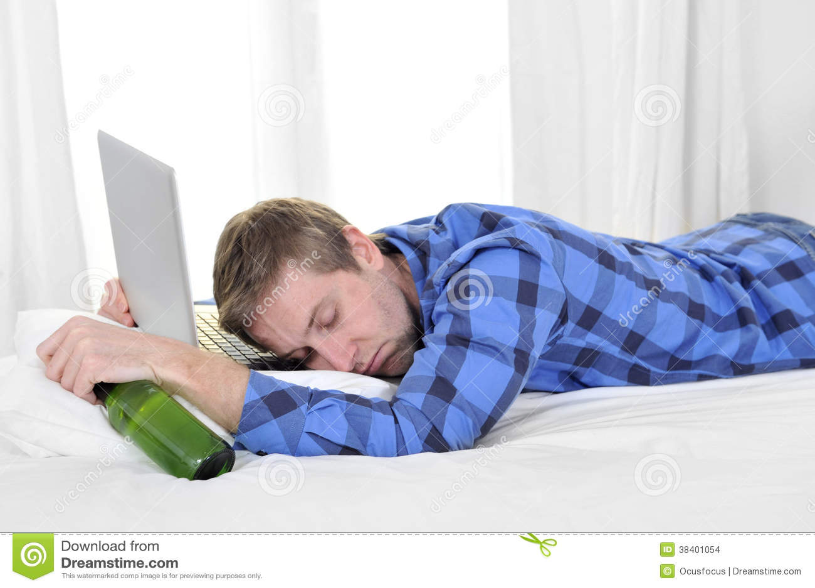 student-overworked-asleep-computer-holding-beer-bottle-38401054.jpg