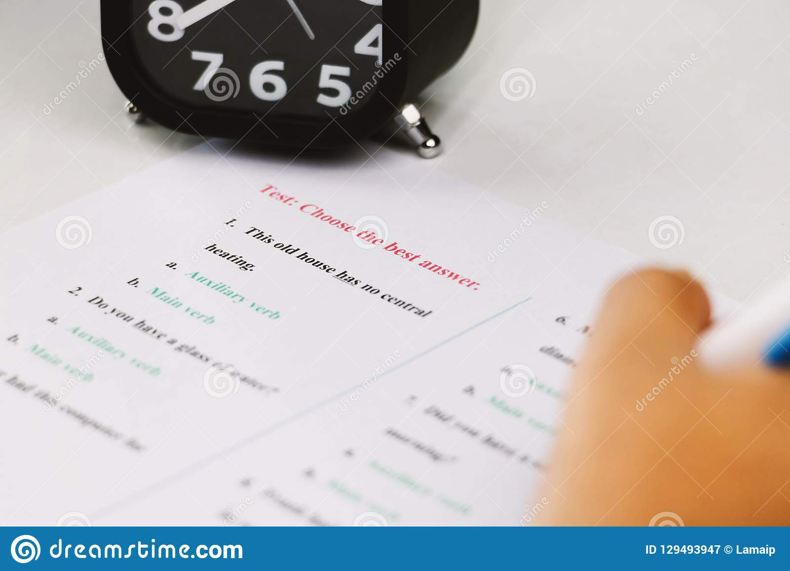 Student`s Hand Taking English Test In Class Stock Image - Image of