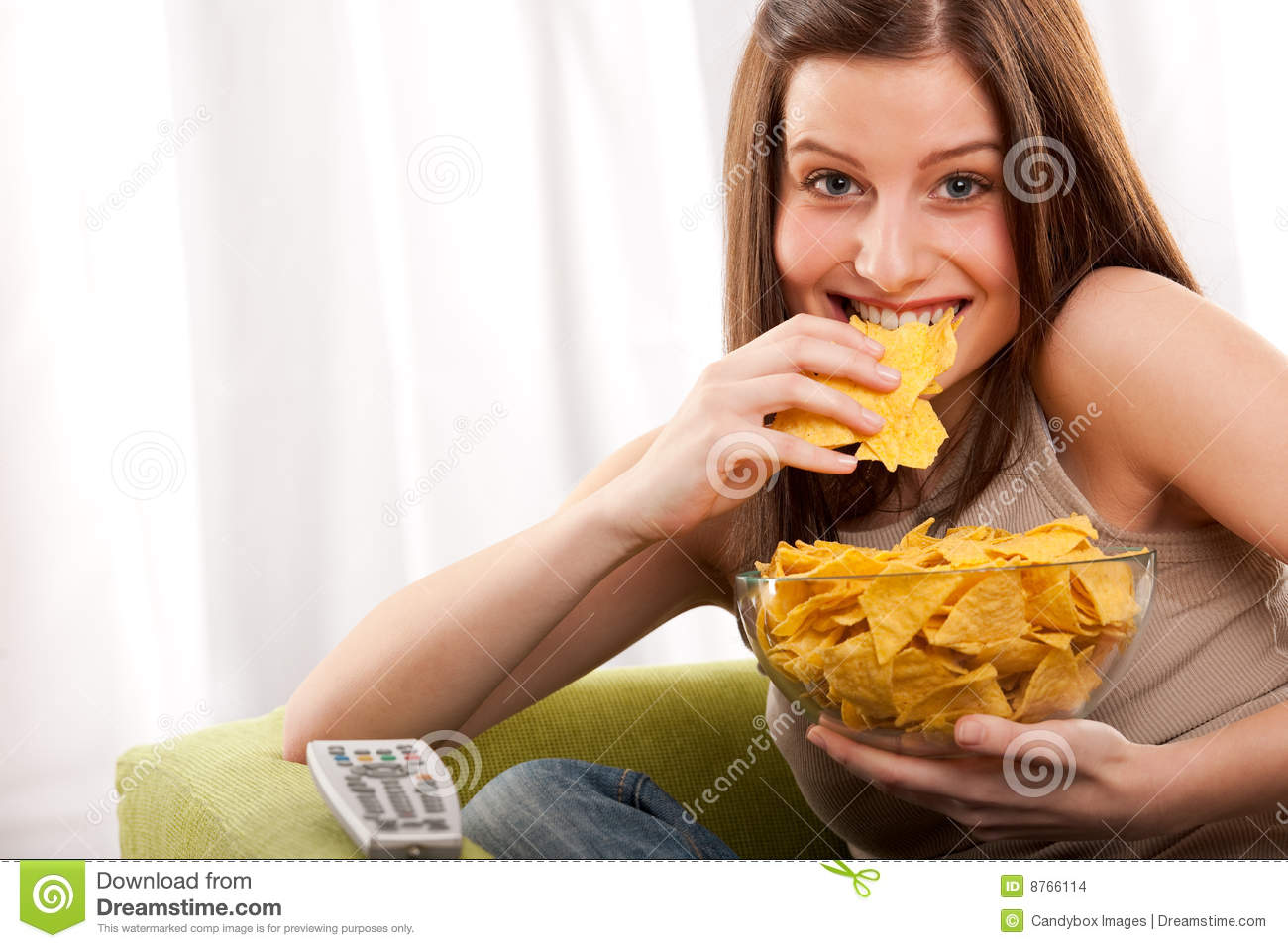 Student Series Young Woman Eating Potato Chips Stock