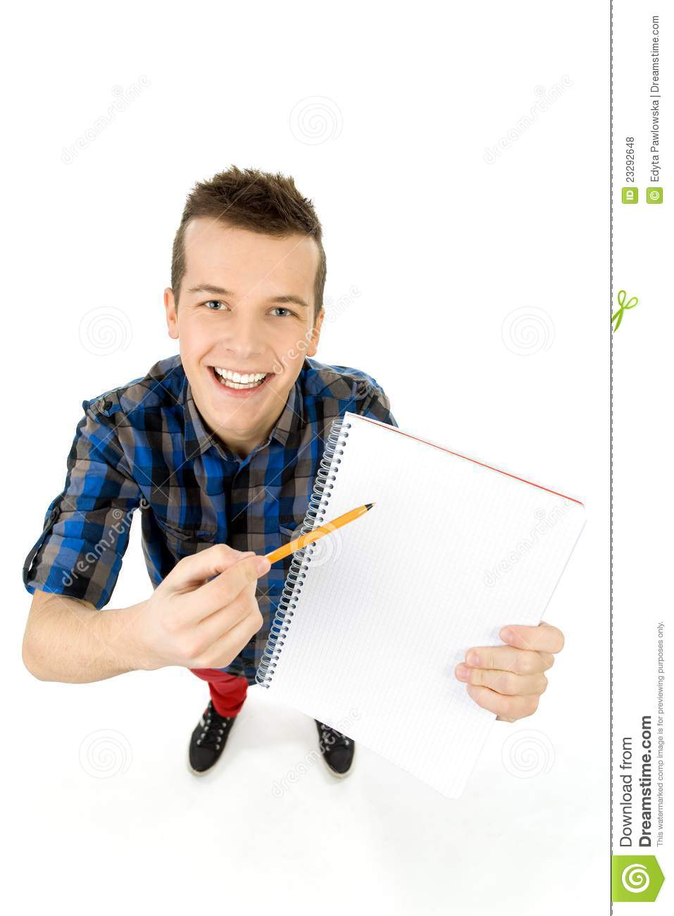 Student with workbook and pen