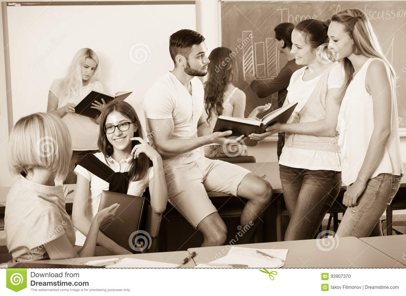 Students chatting while sitting in the room
