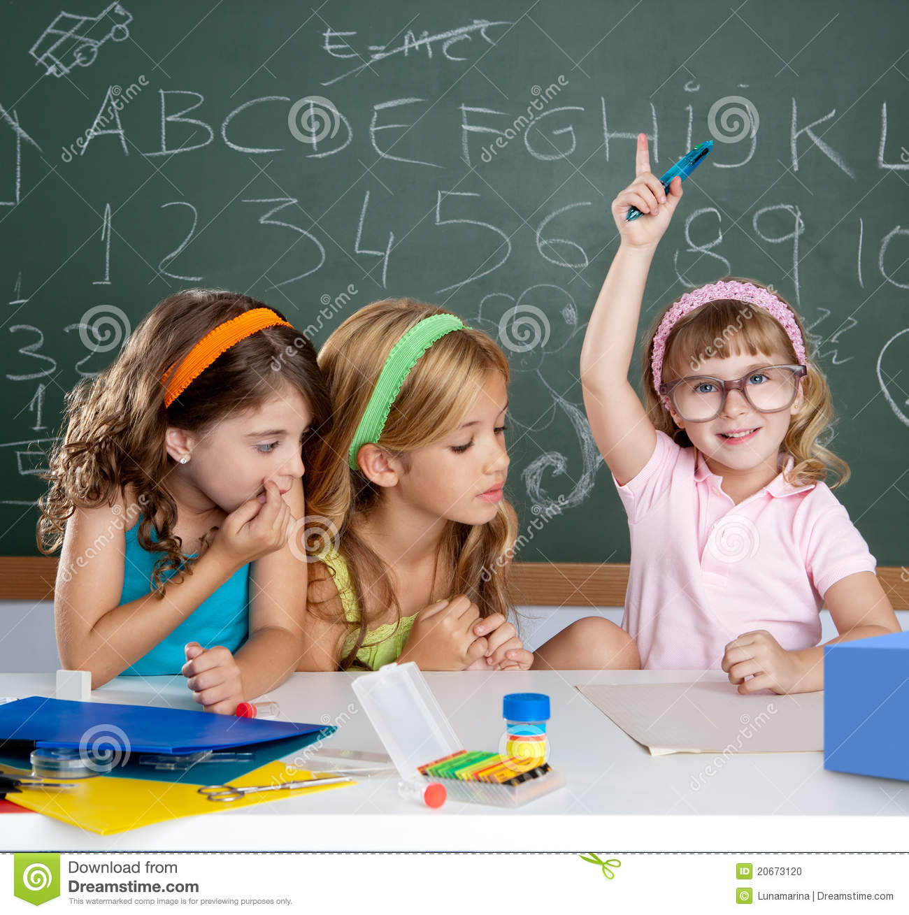 Students with clever children girl raising hand