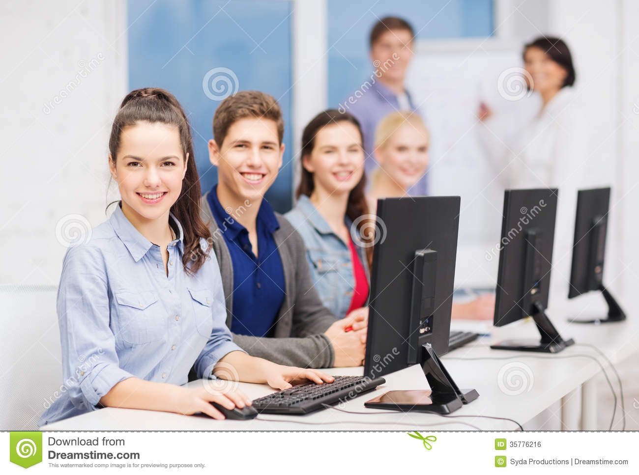 ... concept - group of smiling students with computer monitor at school