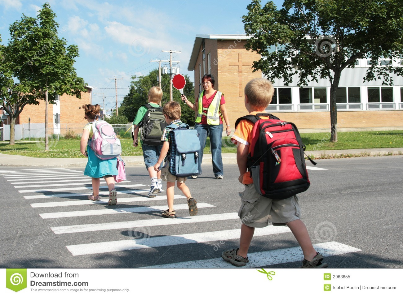 ... on their way to school under the watchful eye of a crossing guard