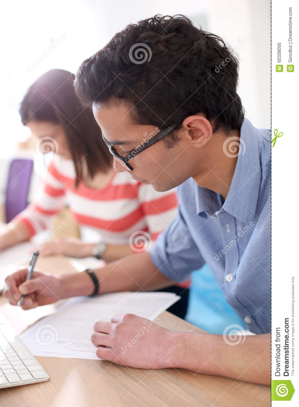 students filling application form stock photo image  students filling application form