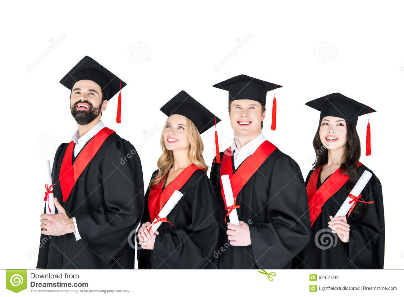 Students In Graduation Gowns And Mortarboards Holding Diplomas On ...