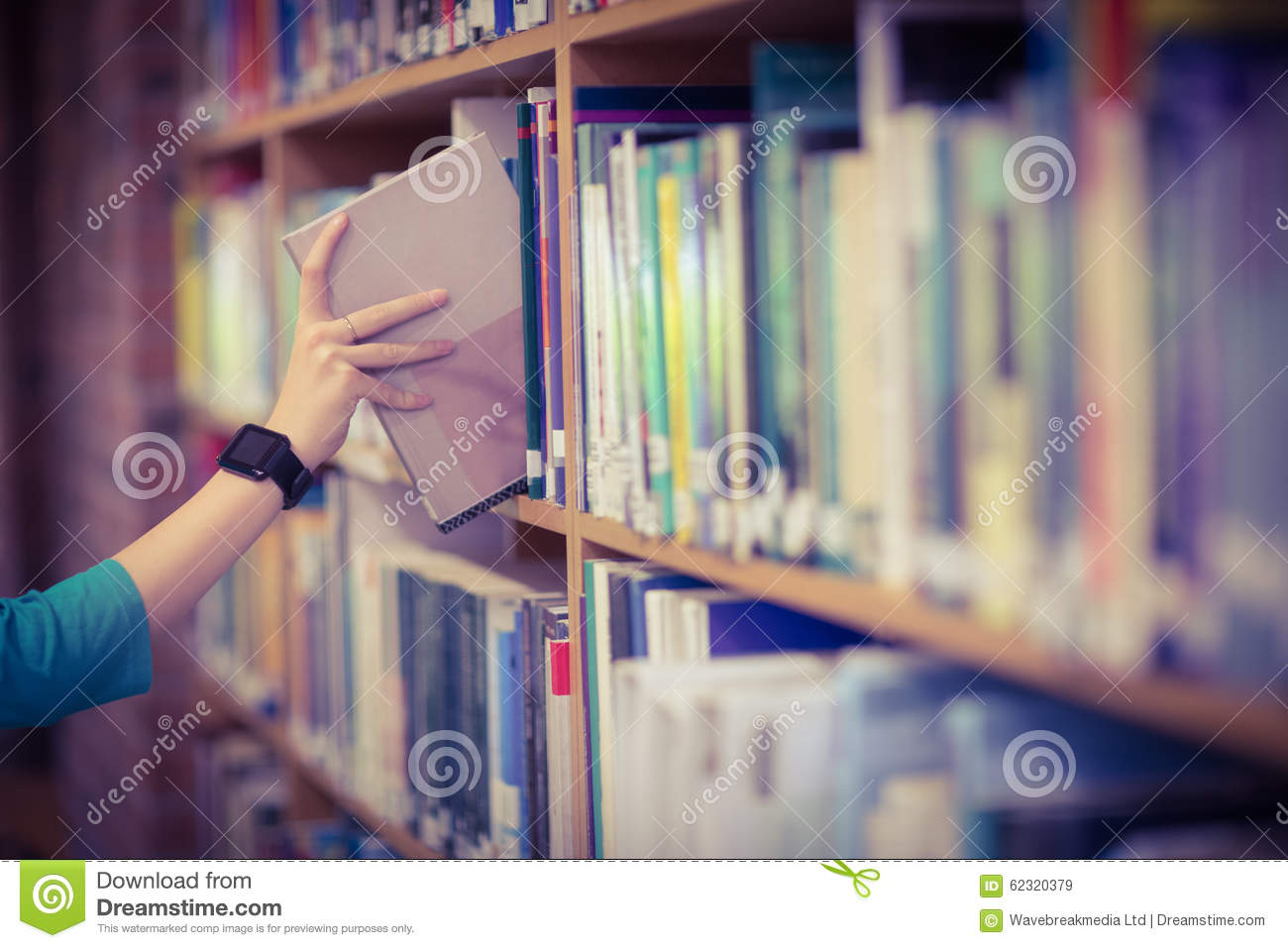 Students Hand With Smartwatch Picking Book From Bookshelf Download Preview