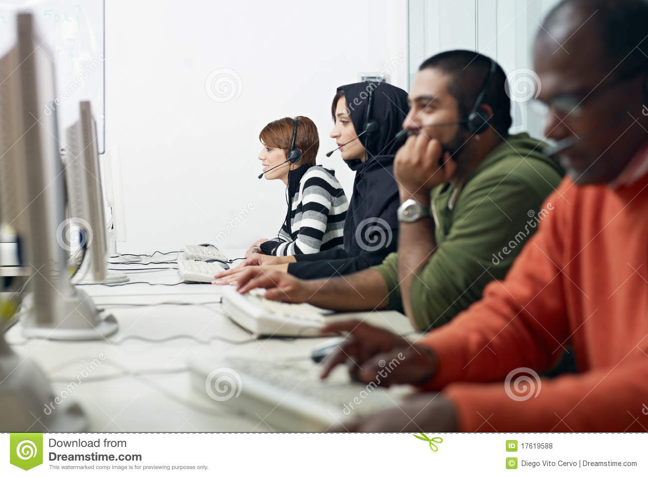 Students with headset in computer lab