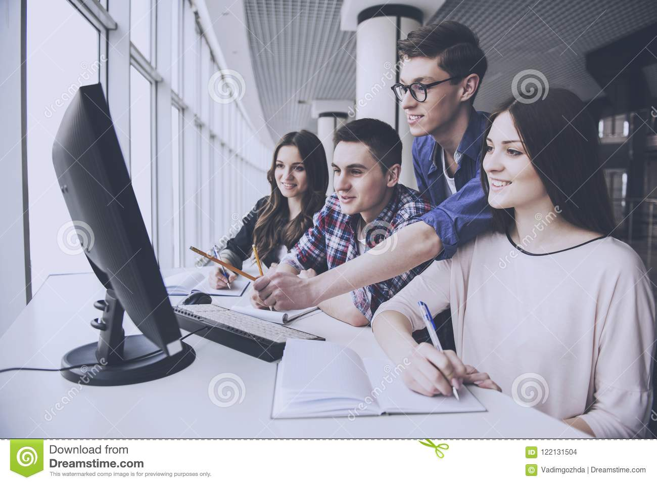 Students are Looking on Computer at University.