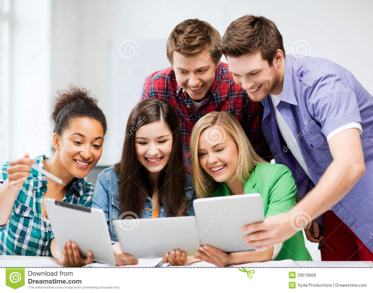 Royalty Free Stock Photos: Students looking at tablet pc in lecture at ...