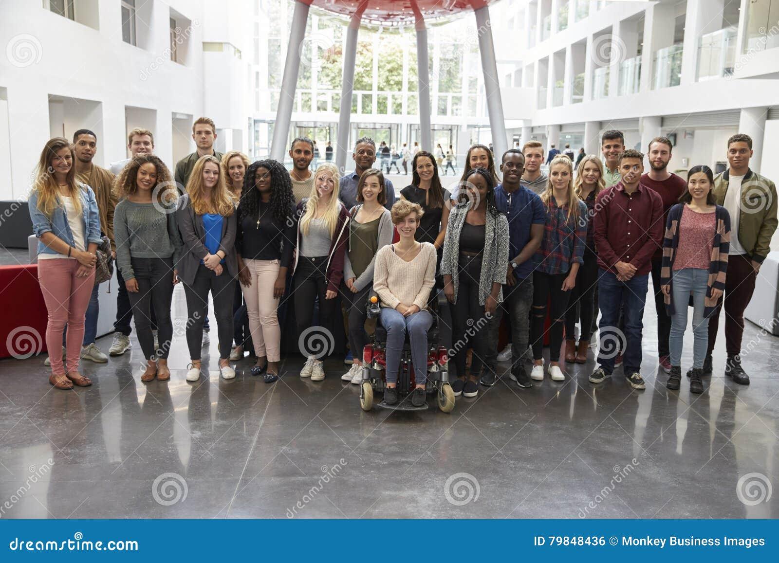 Students in modern university building, large group portrait