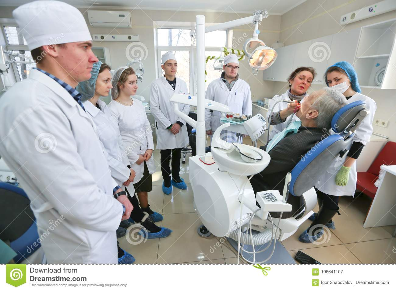 Students Practicing Dentistry On Medical Dummies In A
