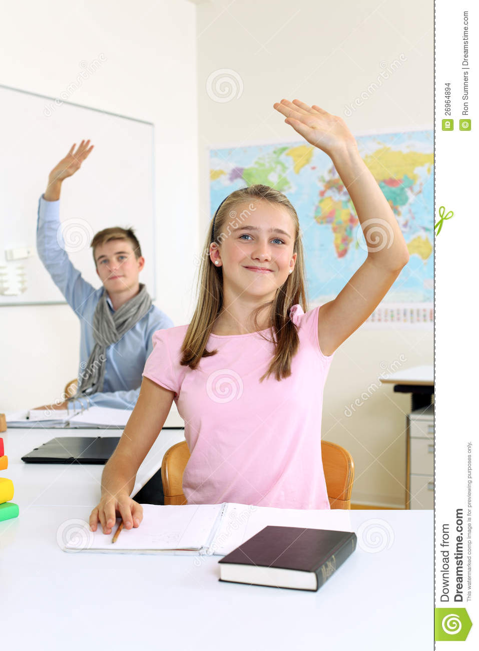 ... two students in their class raising their hands to answer a question