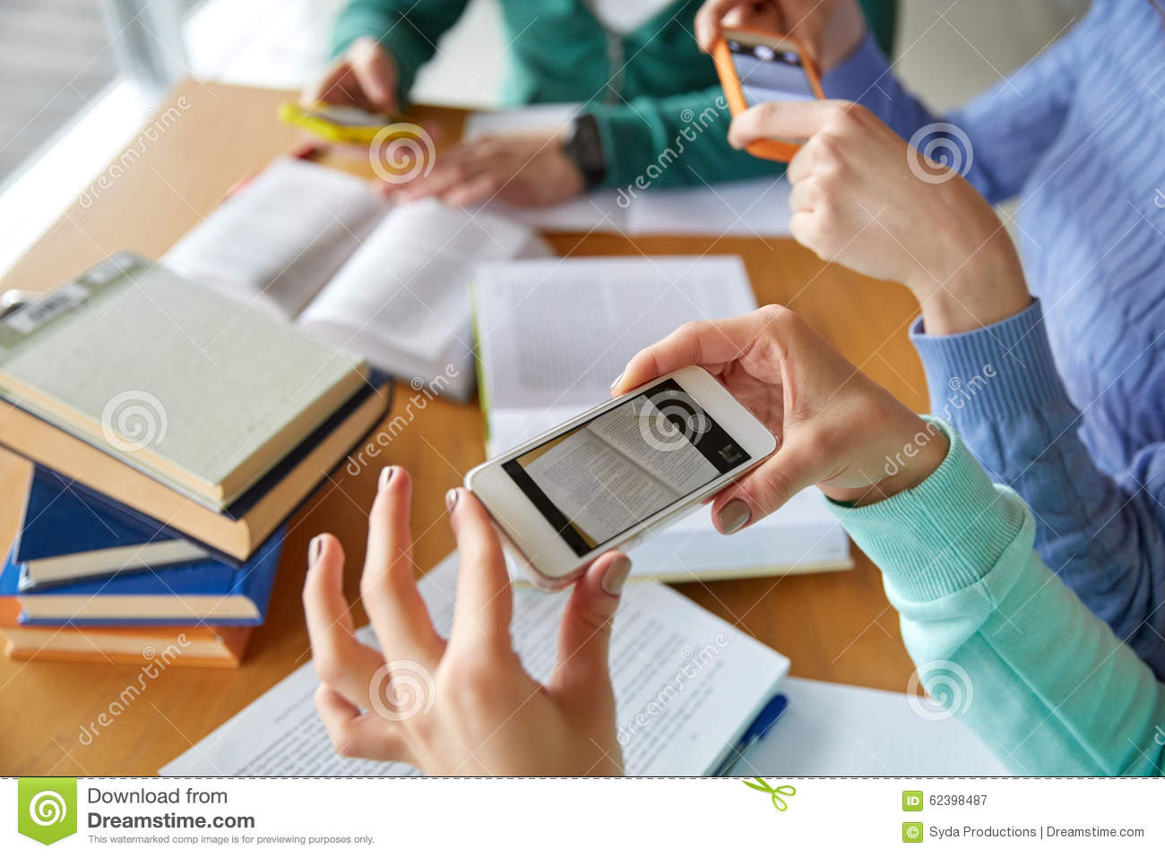 Students With Smartphones Making Cheat Sheets Stock Photo