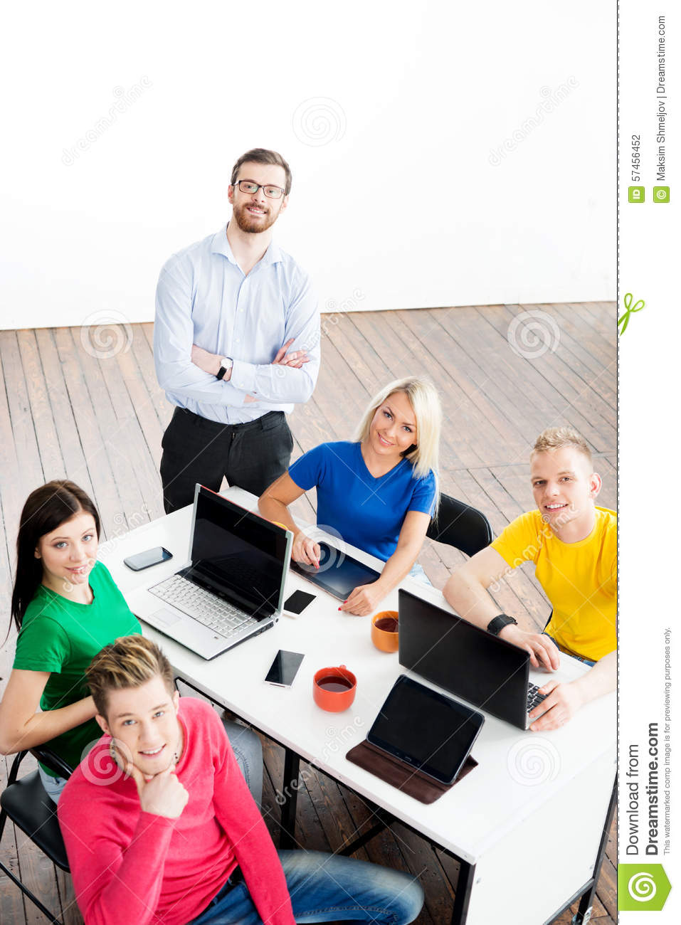 Modern Classroom With Students ~ Students with teacher studying using modern technologies