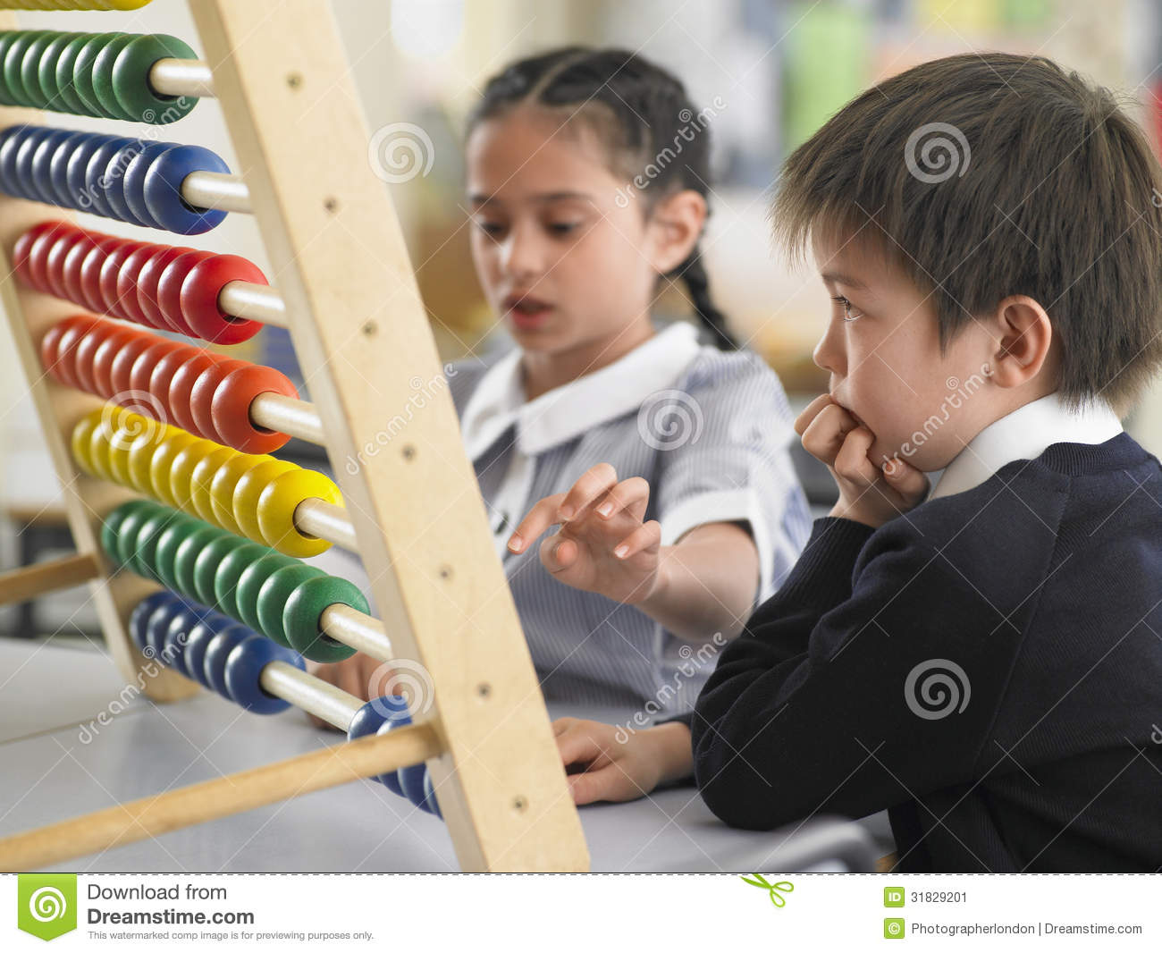 Elementary Classrooms Technology Use : Students using abacus in classroom stock image