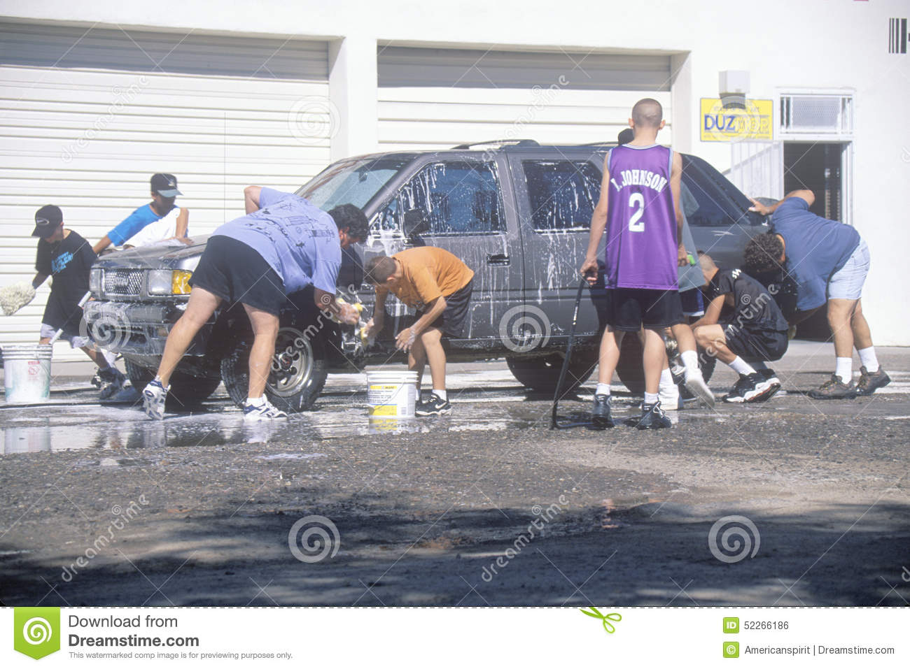 Students washing cars for a school fundraiser, NM