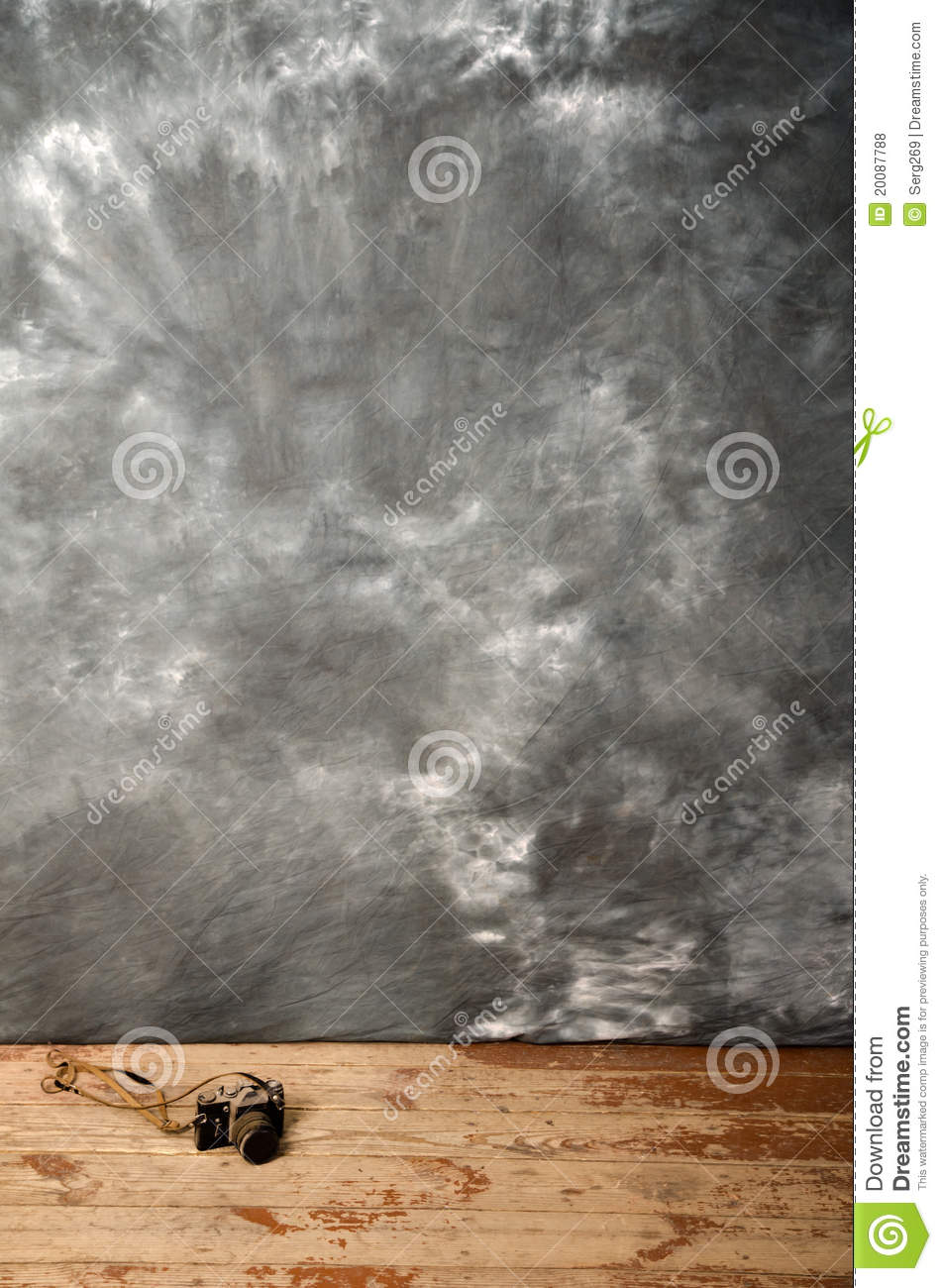 studio background and ancient photo camera royalty free