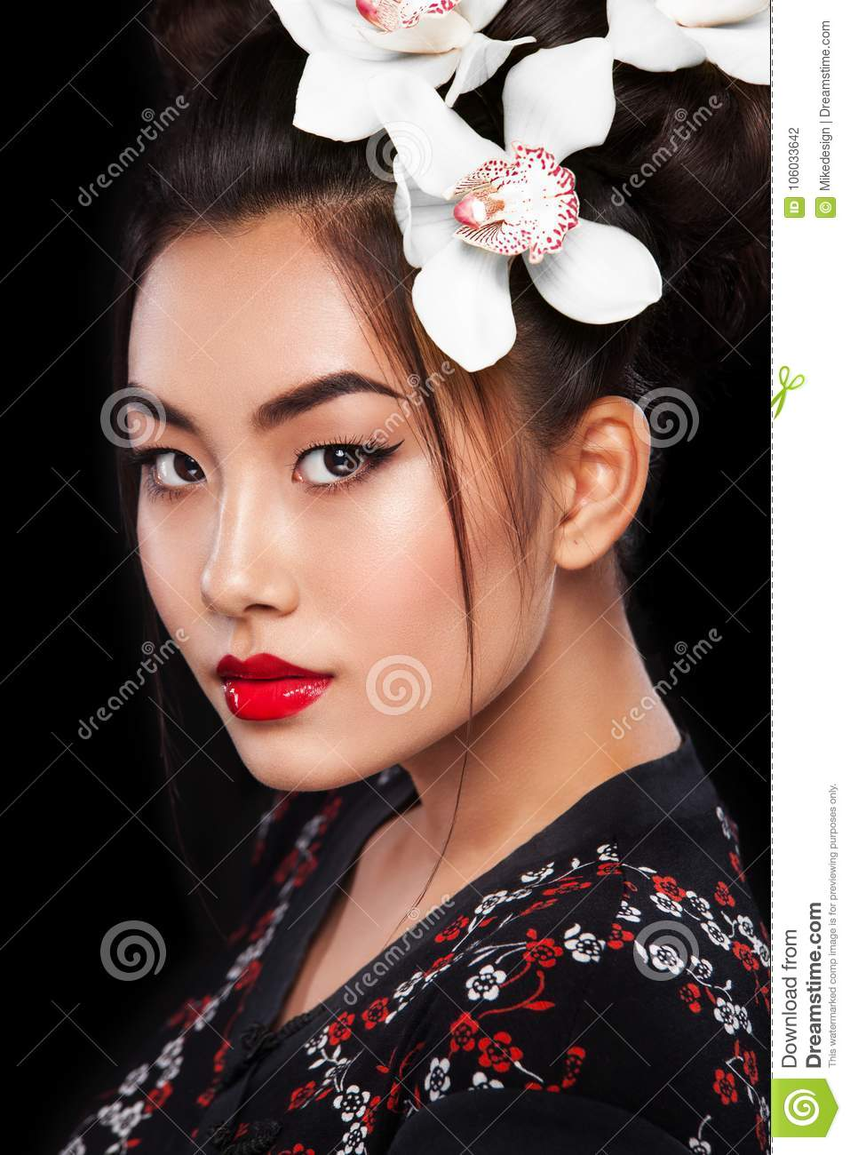 Studio Fashion Shot Of Asian Woman With White Flower In Hair Stock