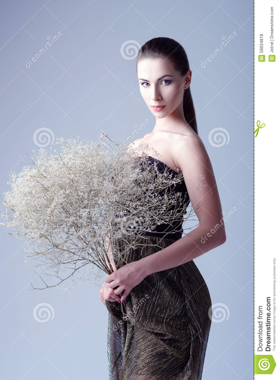 Studio Fashion Shot Beautiful Young Woman In Dress Holding Bouquet Of Withered Flowers Royalty
