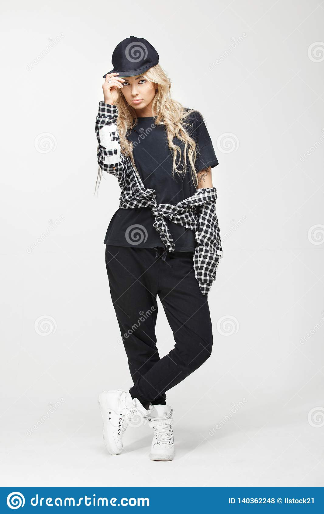 Studio Growth Portrait Of A Stylish Swag Girl In Black And