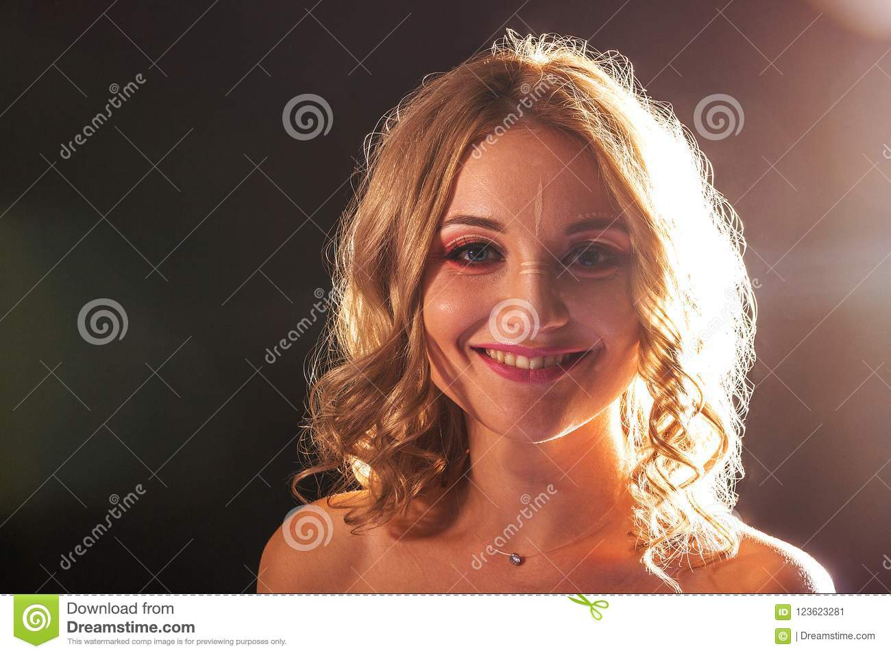 Studio portrait. Beautiful girl with evening make-up on a black background