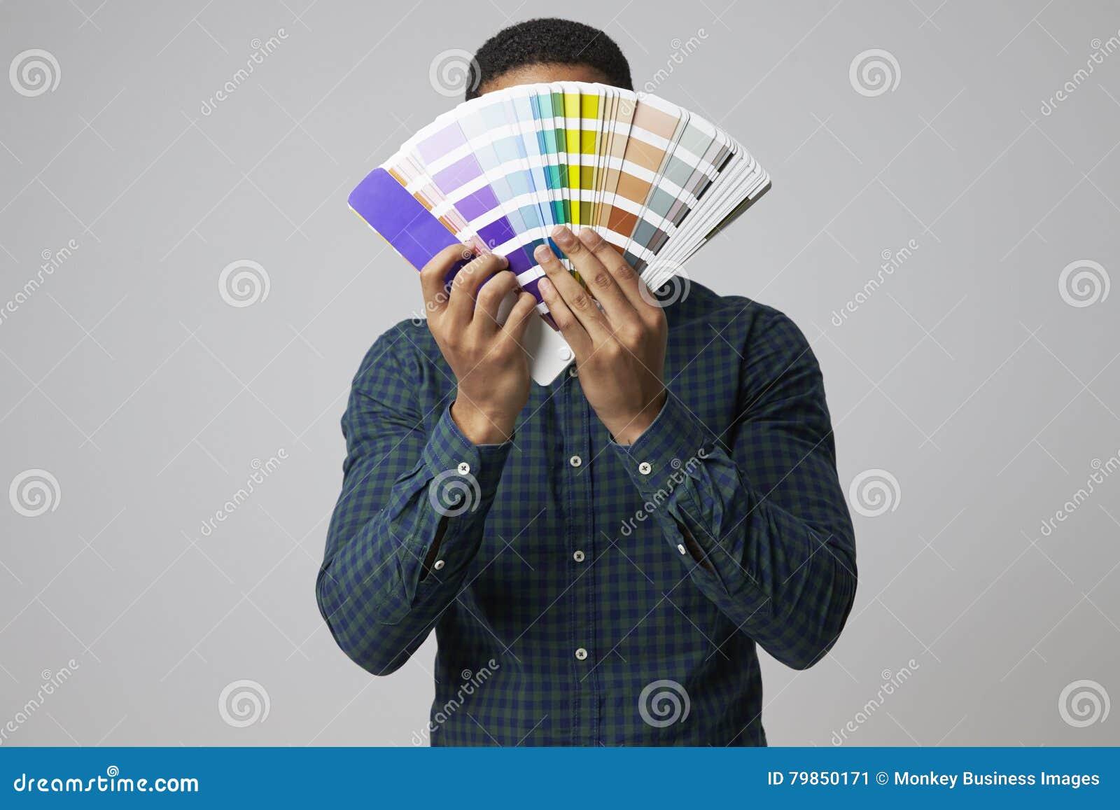 Studio Portrait Of Graphic Designer With Color Swatches