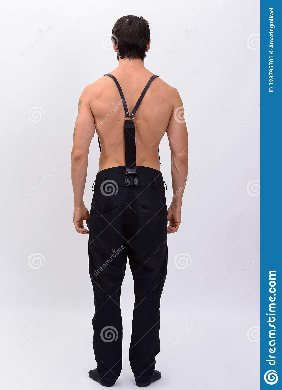 7e3d6c5e20322 Full Body Shot Of Back View Of Muscular Man With Suspenders Shir ...