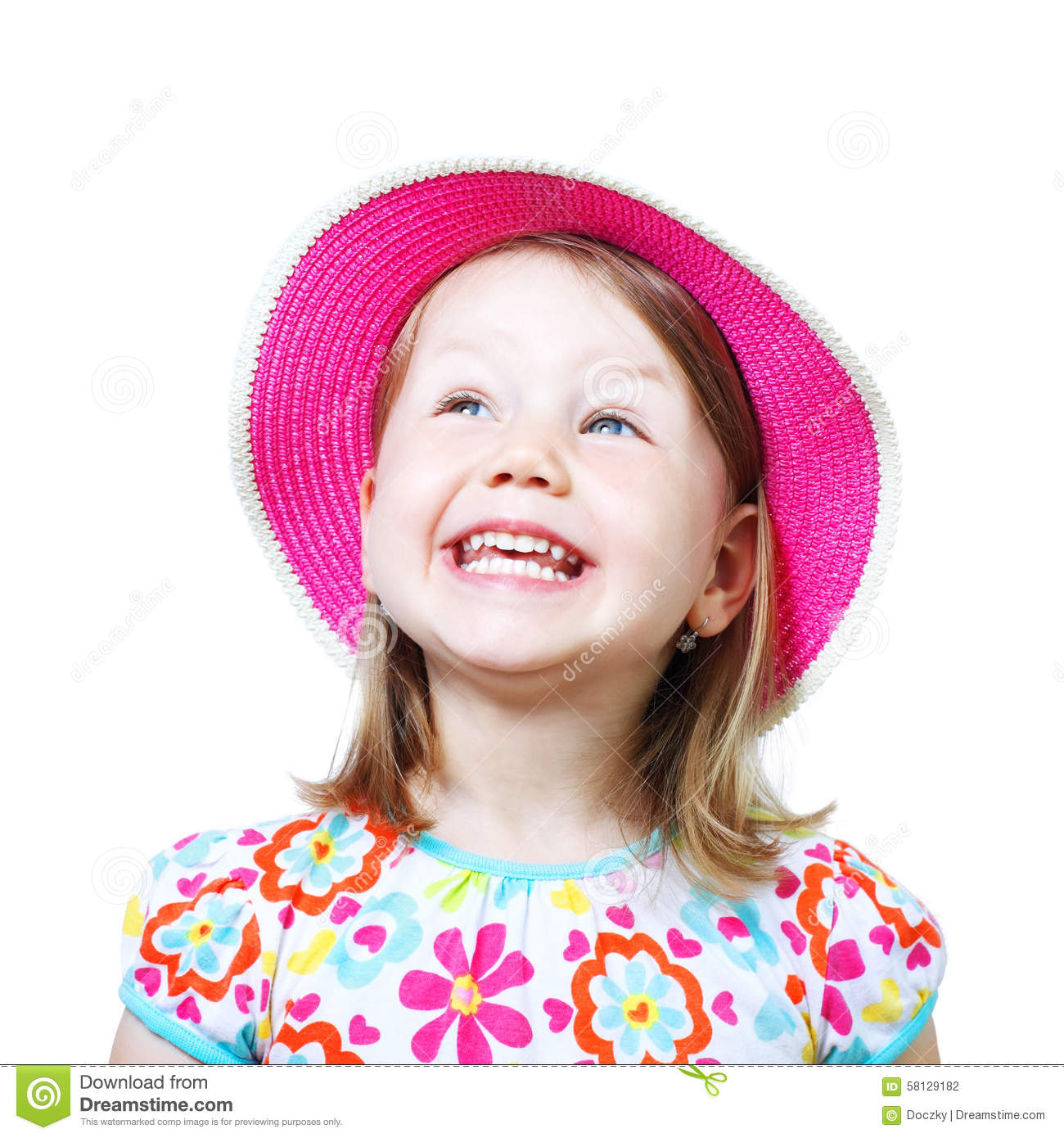 Studio portrait of a smiling little girl with hat.