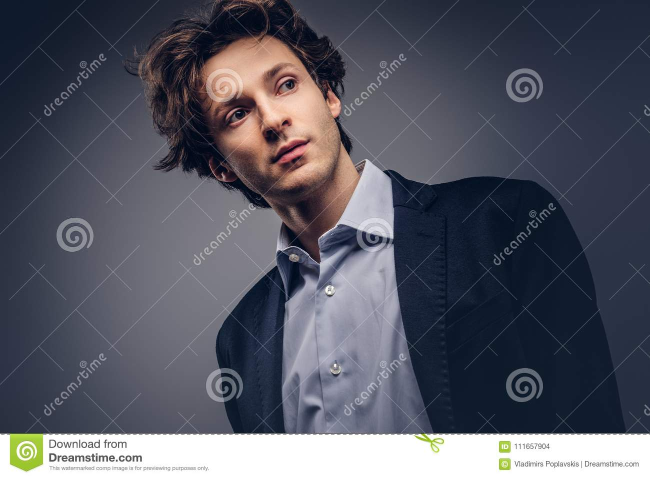Studio Portrait Of A Stylish Sensual Male With Hairstyle In A Casual