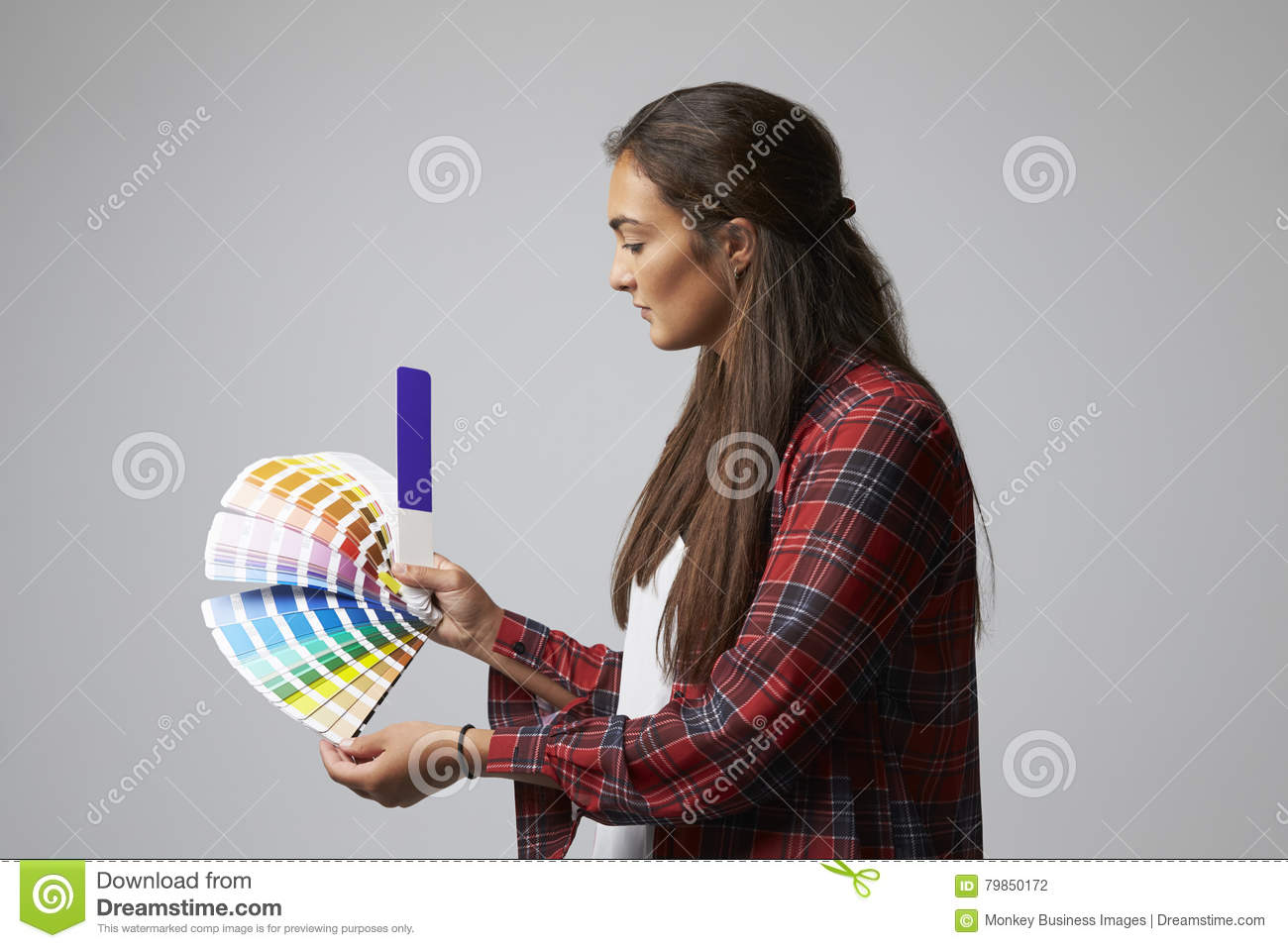 Studio Shot Of Female Graphic Designer With Color Swatches