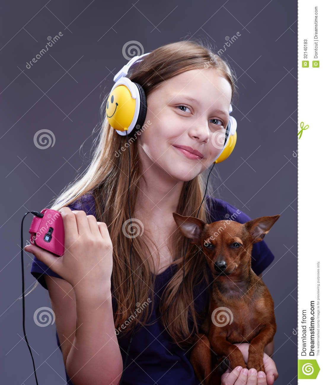 Studio shot of a smiling teen girl with headphones and Tiny girl teen